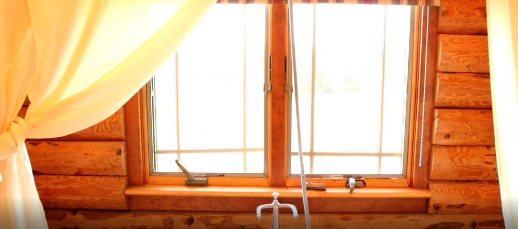Cabin bathroom window in the article how to remove mold from a log home.